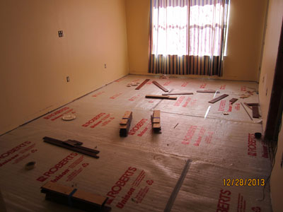 View of master bedroom from main hallway. Old wood flooring has been removed, and all sconcel lights taken out.